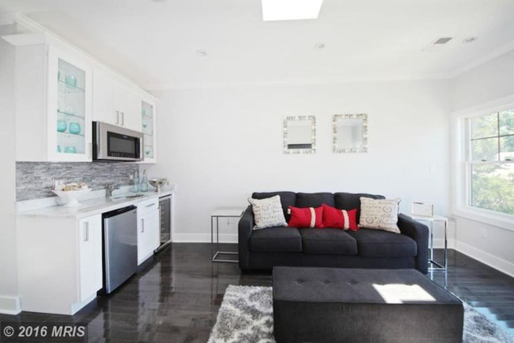 Cozy up with a movie and popcorn in your own master suite living room with wet bar and 60 inch TV