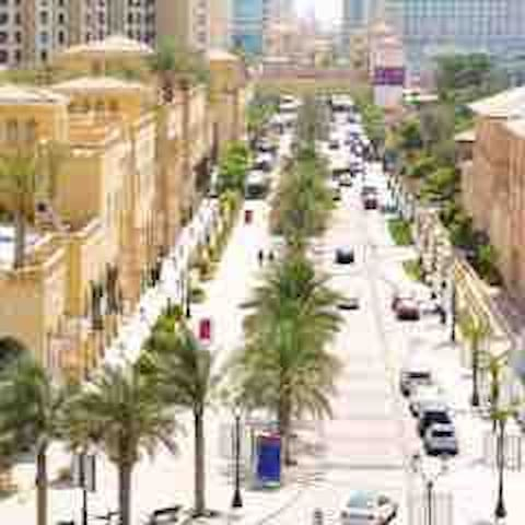 This part of the JBR walk is about 5 mins for the apartment. This walk is alongside the whole beach. A part of this beach is free public access and about a 10 mins leisurely walk. You can rent sun beds for about $30 per day.