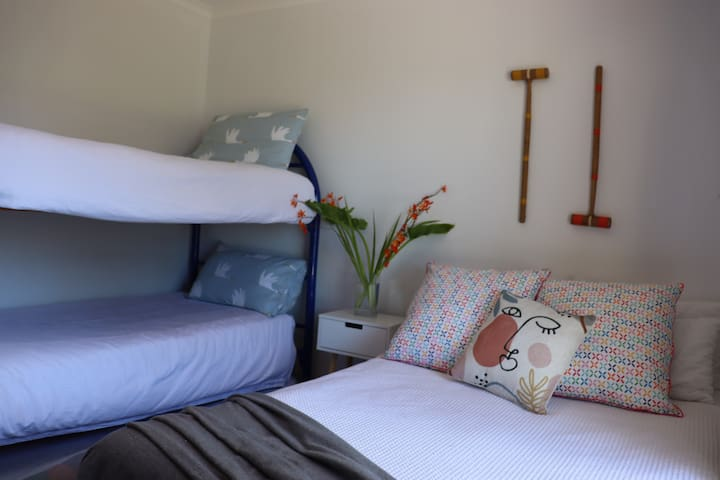 Second bedroom with single bunks and double bed