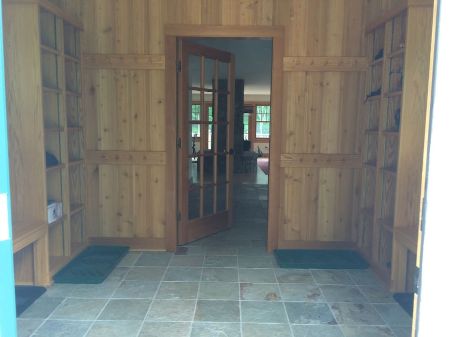 Mud room with warm radiant heated floor and plenty of benches and cubbies for all your ski gear!
