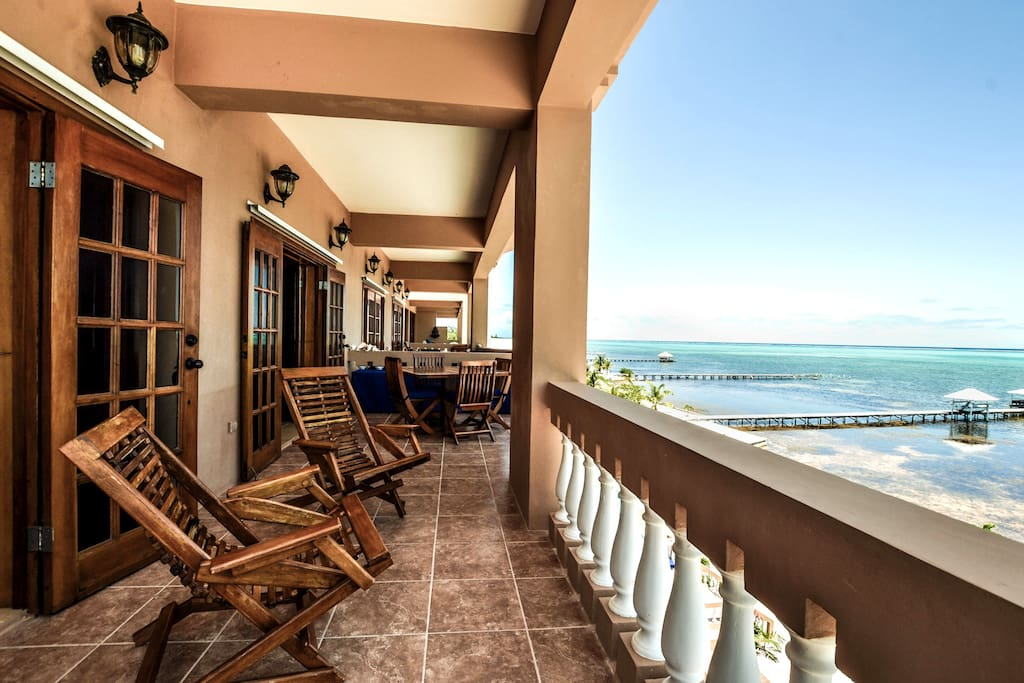 Spacious balcony contains both living AND dining furniture!