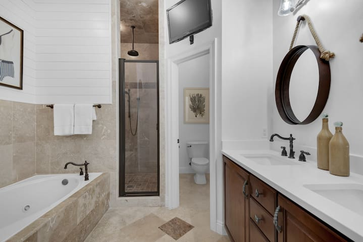 Masterbath features travertine and shiplap jacuzzi tub, separate travertine shower, double quartz vanity and of course a flatscreen tv.