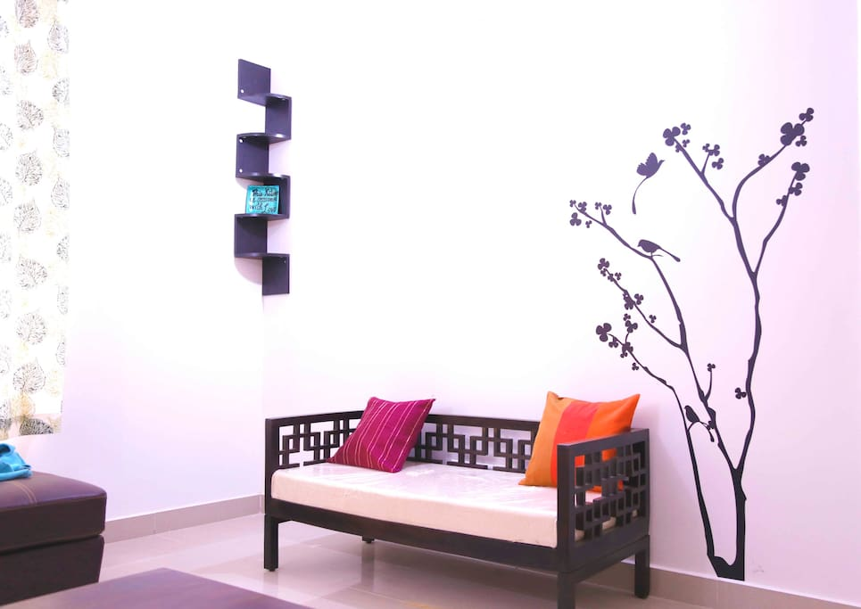 Wall art with sofa and corner shelf