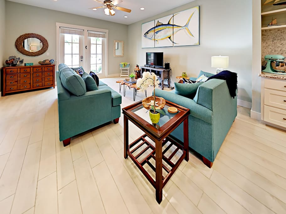 The cool-hued living room offers comfortable seating and plenty of natural light.