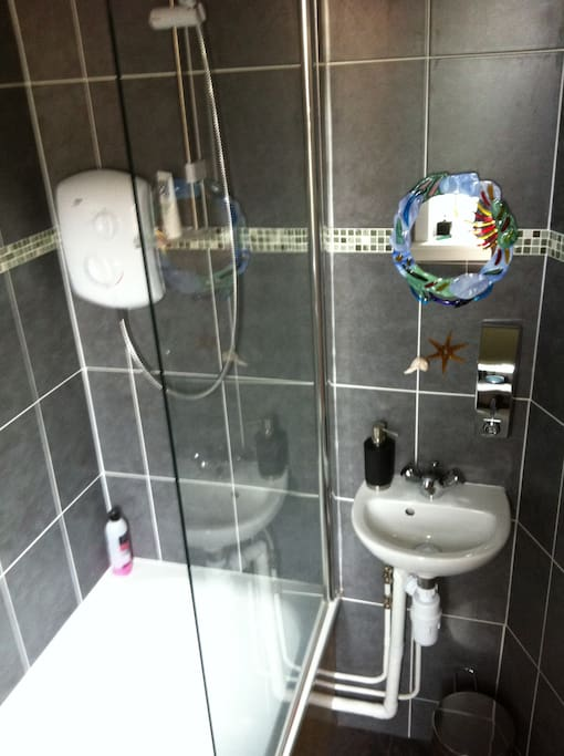 Modern Shower and bathroom fitted,so relax in a nice hot bath after a day golfing or sightseeing.