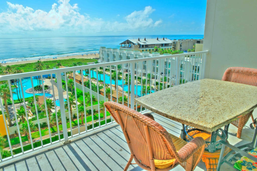 Beach View from private balcony with granite table and chairs