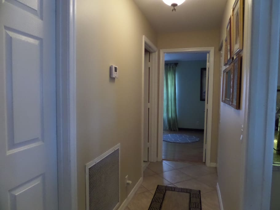 Hallway leading to bedroom and bath. Has pocket door for added privacy