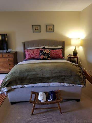 Queen sized bed in upstairs bedroom #2.