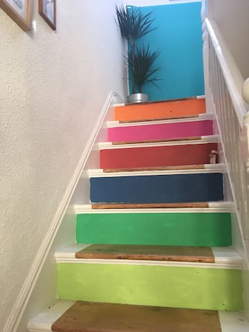 This is my hand sanded, hand painted hallway which I call the stair way to Wonderland - these stairs are private from the living space to the air b and b rooms above