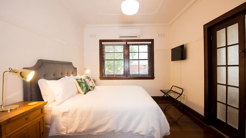 Master bedroom with Queen bed, flat screen TV, and reverse cycle air con.