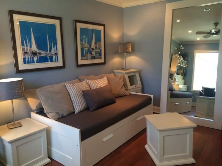 Daybed in livingroom converts to king size bed.