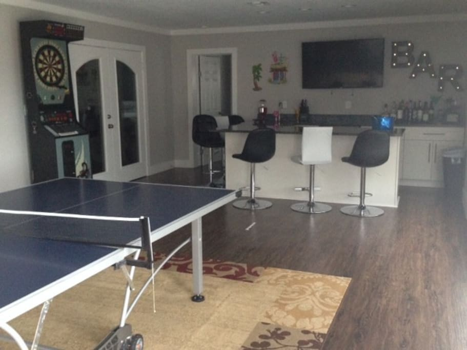Large Family Room with wet bar, refrigerator and TV
