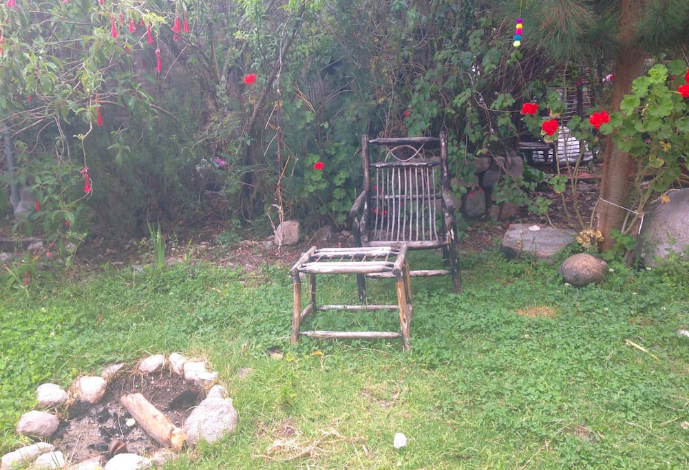 Relaxing garden full of hummingbirds, and surrounded by the serene sound of running water