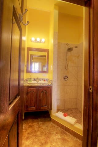 Modern bathroom, hot water, large  walk in shower, bath & beach towels, mahogany & granite , wardrobe & hangers . Cleaning of rooms are only done upon request.  Sleeps 4