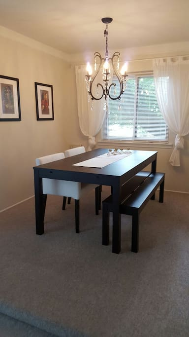 Attached to the main living room is the dinning room.  Not only are the chairs comfy, the bench allows for extra room to set up a board game!