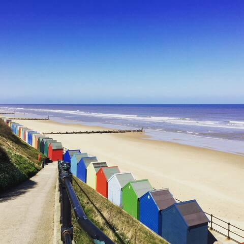Mundesley's beach hut lined promenade & blue flag beach
