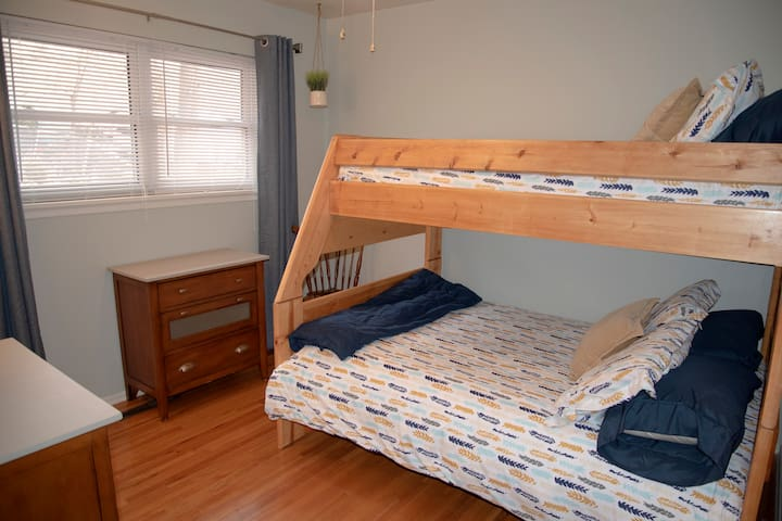 Bunk bed room with full on bottom and twin on top.