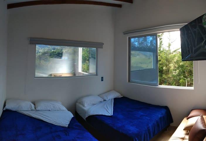 Cabana 1  Bedroom 1 two queen beds