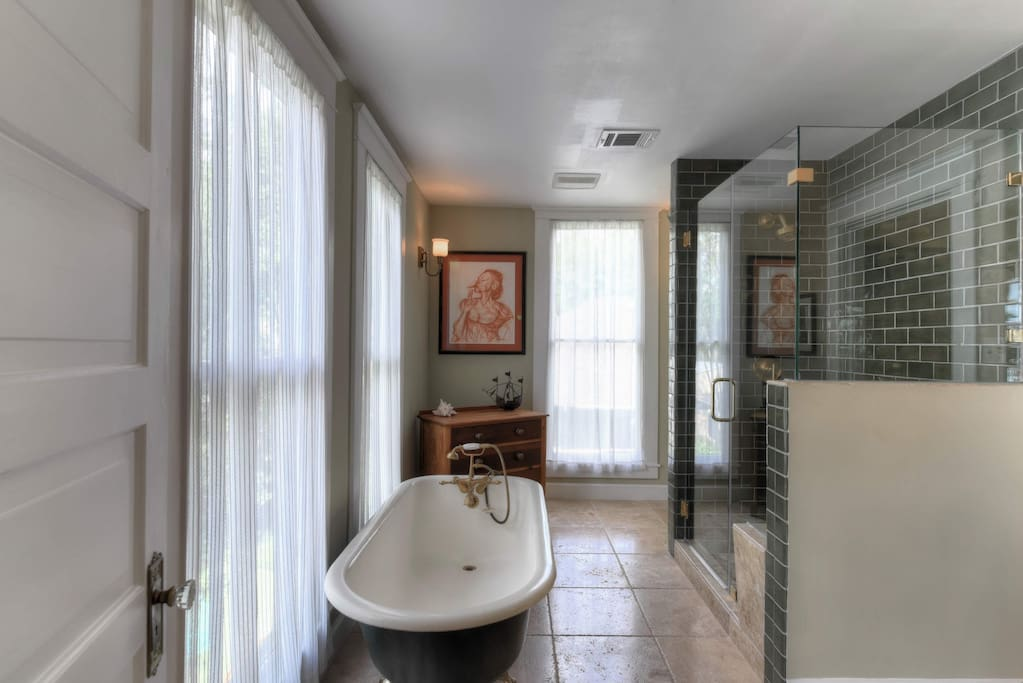 Full bathroom with stand up shower (and bench) and clawfoot tub.  Sink is marble top.