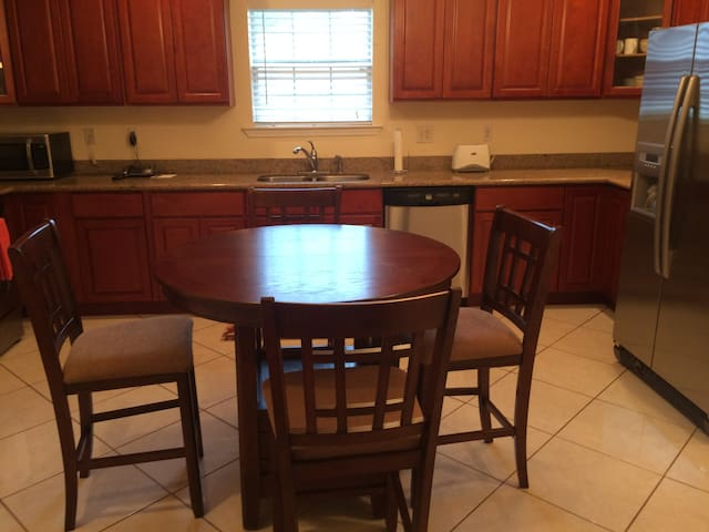Large kitchen area with all the amenities. Seating for four.view of kitchen . Seats four adults. Maybe high for small kids.Has gas stove, electric oven and microwave oven.