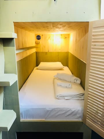 Cozy bed in a dormitory room - Capsule