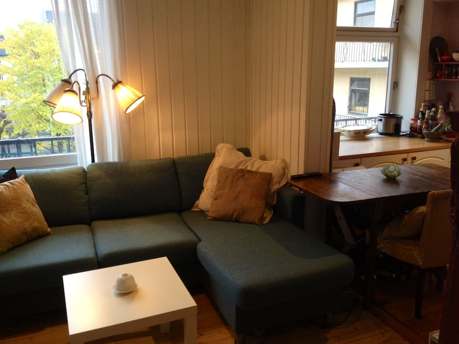 Living room and kitchen with small table