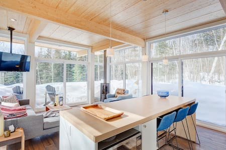 Modern forested cabin near Tremblant