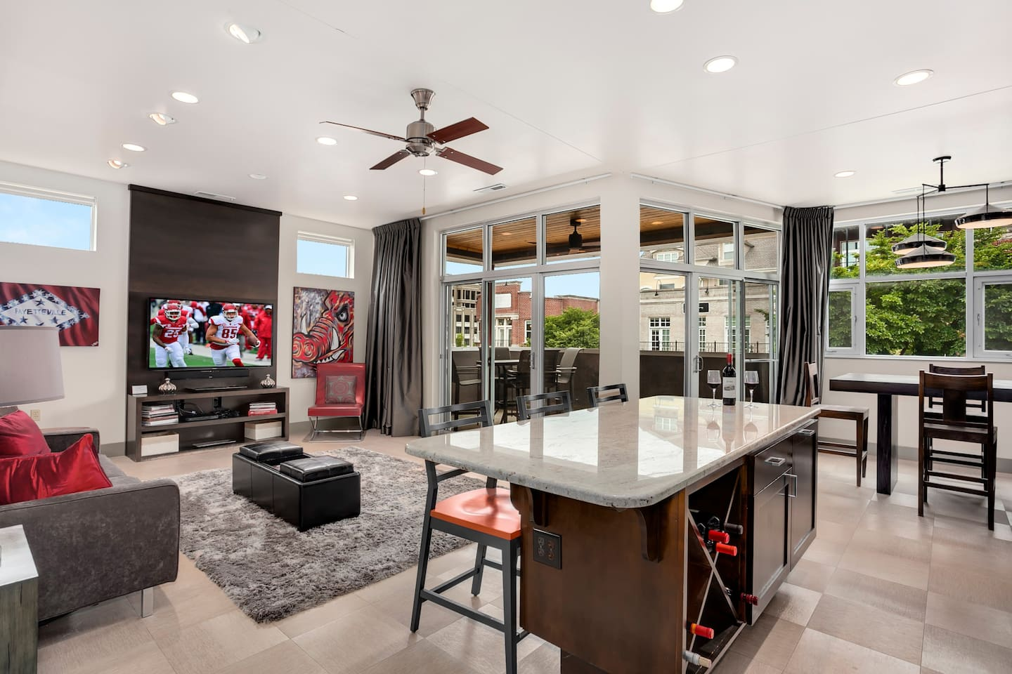A giant HDTV, floor to ceiling windows, and a red + black decorated living room will have you calling the hogs upon arrival!