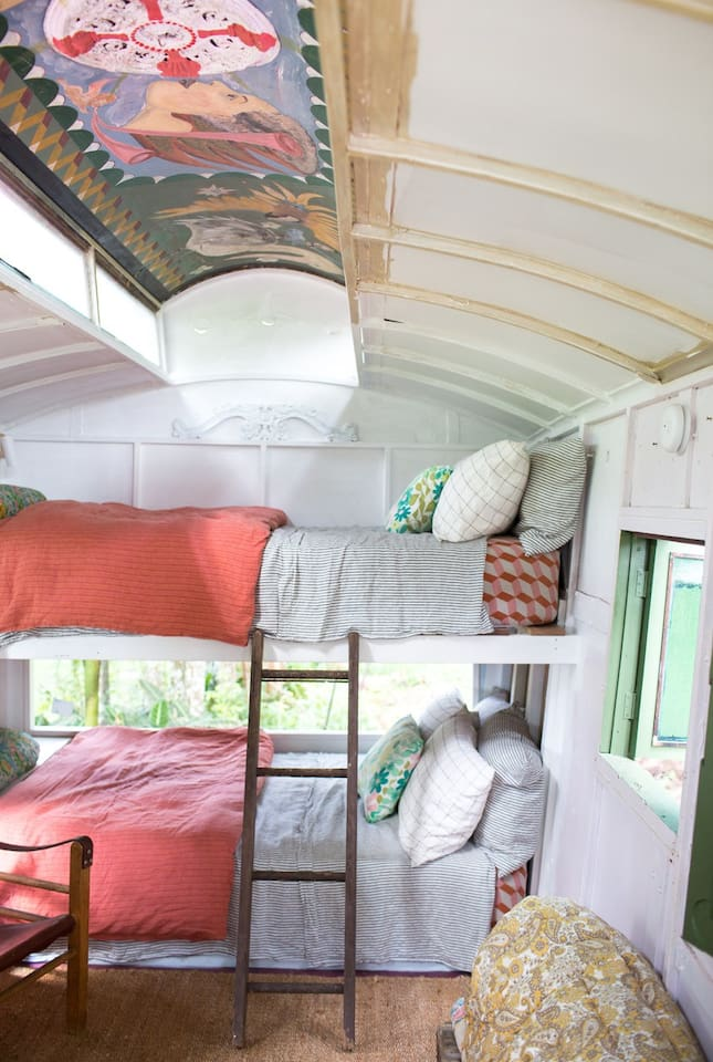 Painted ceiling inside the Gypsy caravan. Society of wanderers linen. Toilet and basin inside. Nothing but the sound of the tree's and the nearby creek.