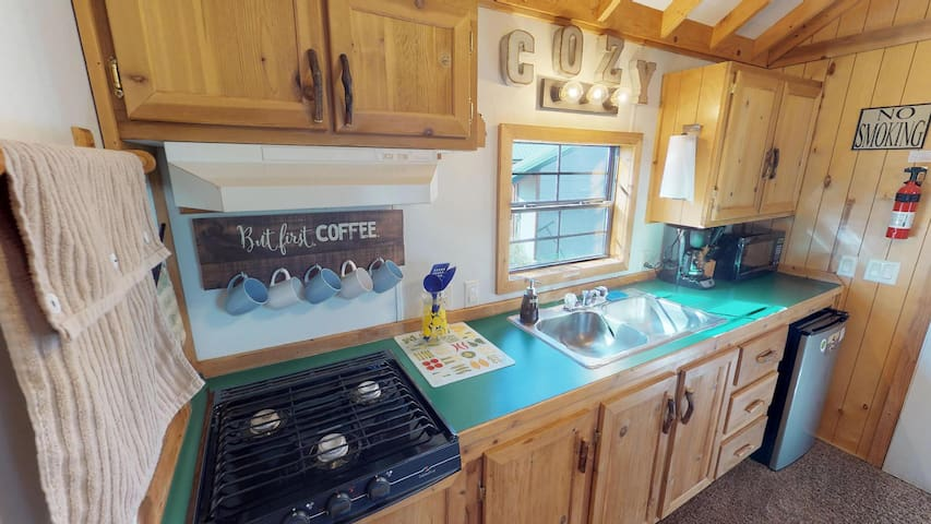 This cozy kitchen has the necessities needed for making a small meal or brewing up a cup of coffee.