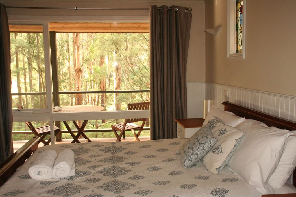 Bedroom with stunning views of the mountain ash tress