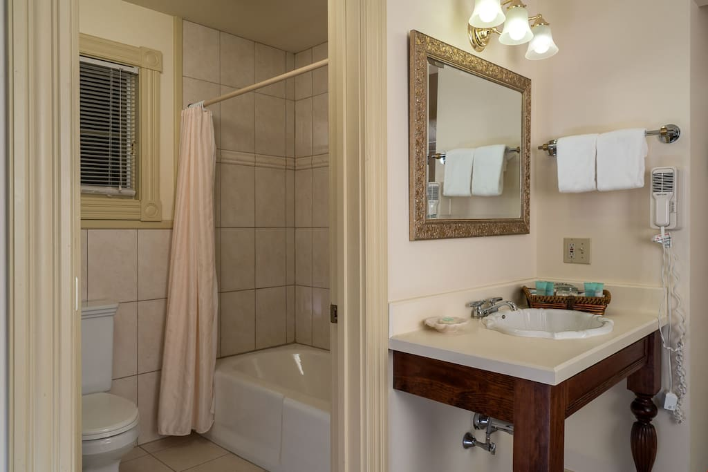 The pristine bathroom is the perfect place to get ready for a fun day outside.