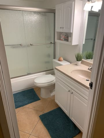 The bathroom is well-maintained and spotlessly clean.