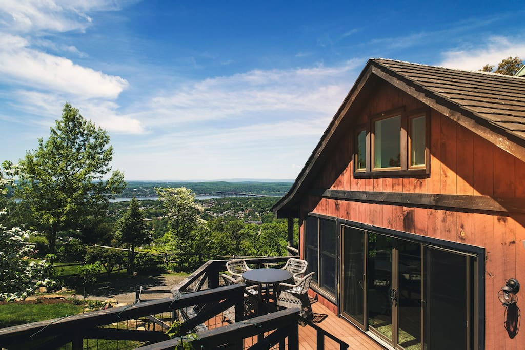 The south deck has outdoor seating and a Weber grill for enjoying the views