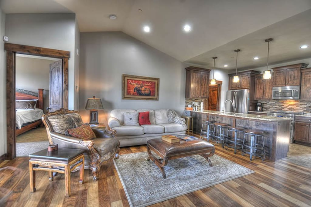 """Main Level Living Room - 55"""" HD TV, Sonos Sound Bar, Gas Fireplace, Plenty of Seating, Access to Patio"""