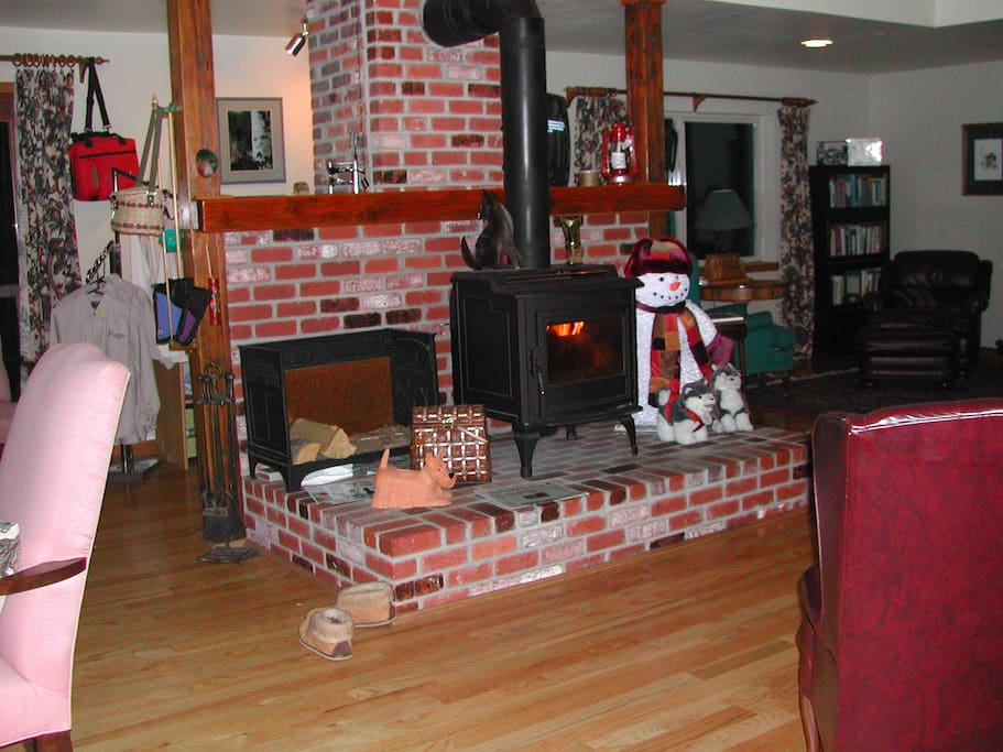 Huge Great Room on the ground floor with cozy wood stove can accommodate all sorts of activities and gatherings.