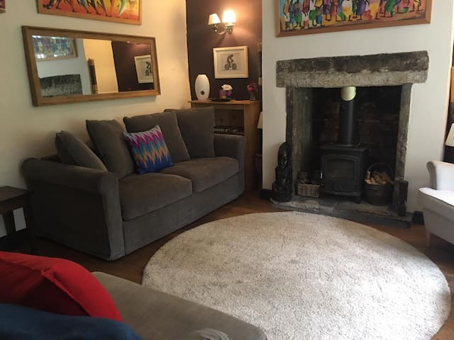 The cosy lounge is decorated with art and artefacts from our travels and has a lovely log burning stove