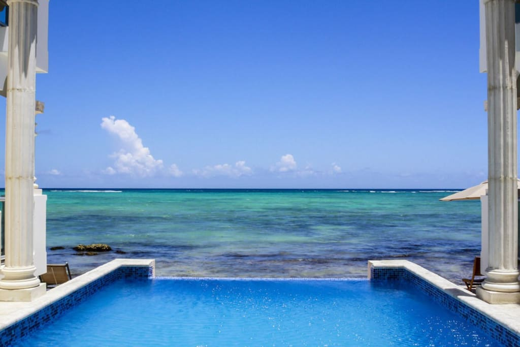 Our infinity pool next to the beach.