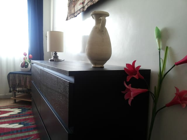 A six-drawer dresser in the room for your convenience