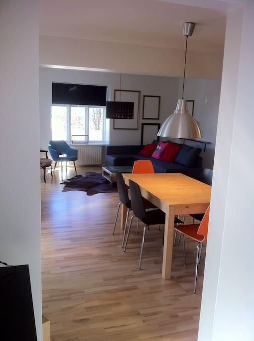 The dining area with the living room in the background