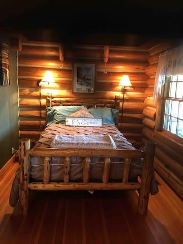 Custom made full size log bed.