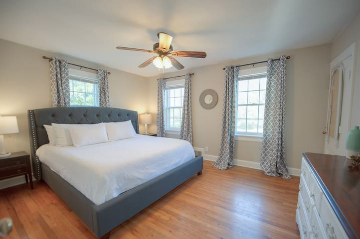Our comfy king bed is waiting for you!  The main bedroom has a large dresser and closet as well.