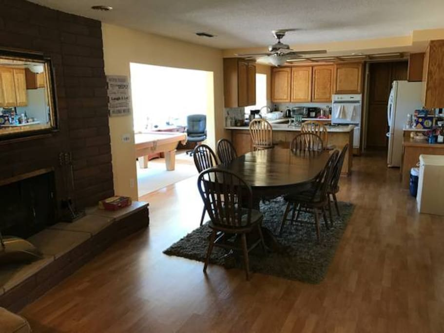 Open, airy kitchen and dining area with gas burning fireplace can be reserved for your guests.