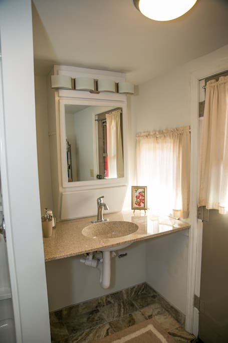 Bathroom with Shower and Vanity. Private Exit
