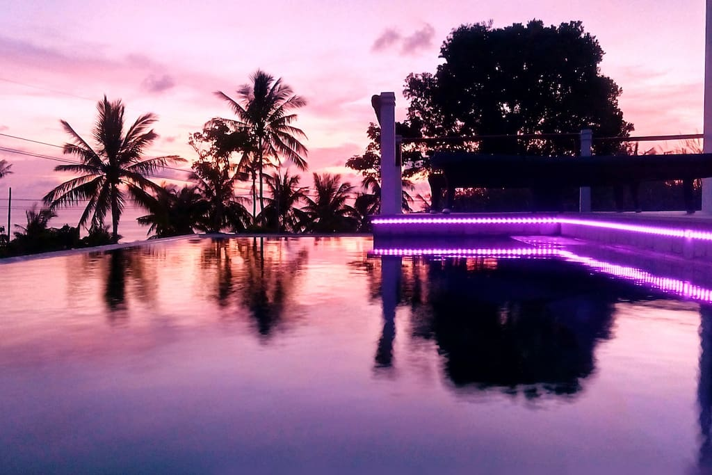 Sunset with the colour changeable LED lighting of the pool