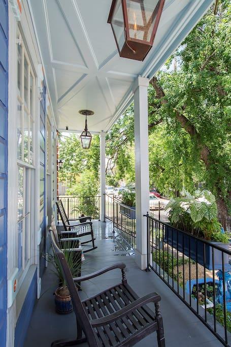 The front porch features authentic gas lanterns