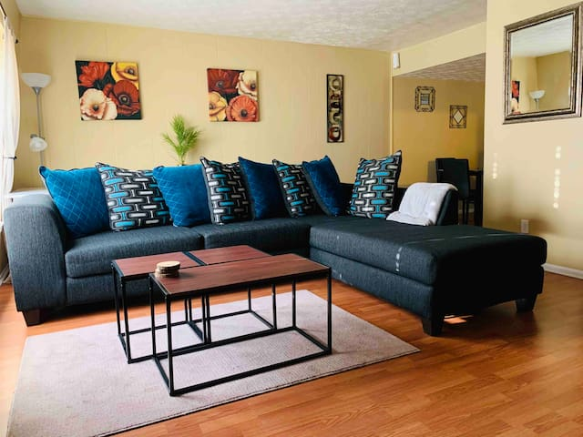 Sectional couch with coffee table in living room.