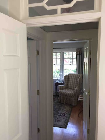 Entrance to  bedroom with queen bed and  reading nook.