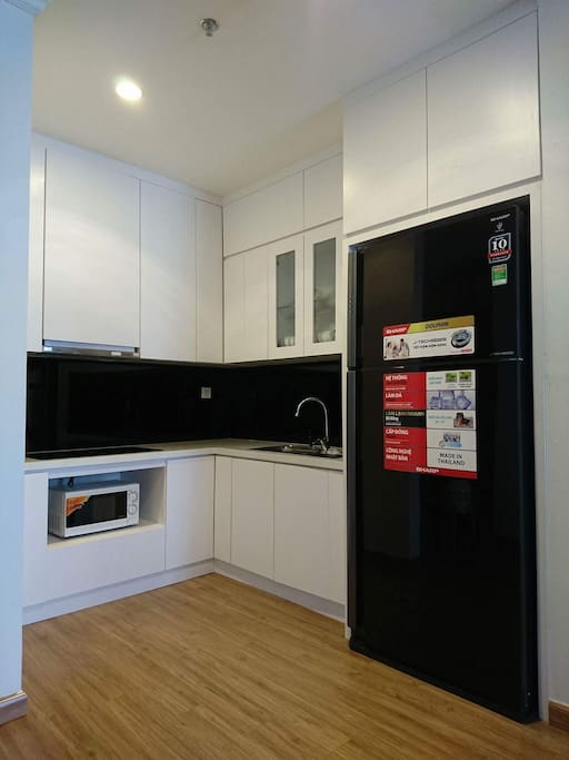 Here is the kitchen full equipped, modern frigo. We put tea/coffee/bread/noddle here for your breakfast.