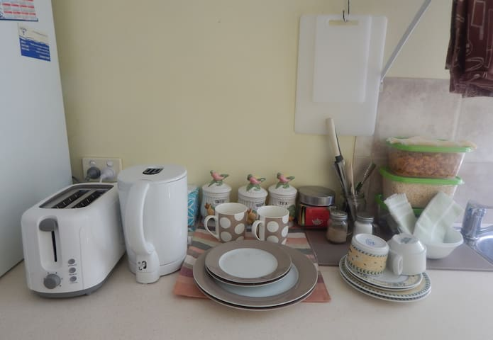 Ingredients for a light breakfast are provided for guests, in utility room.